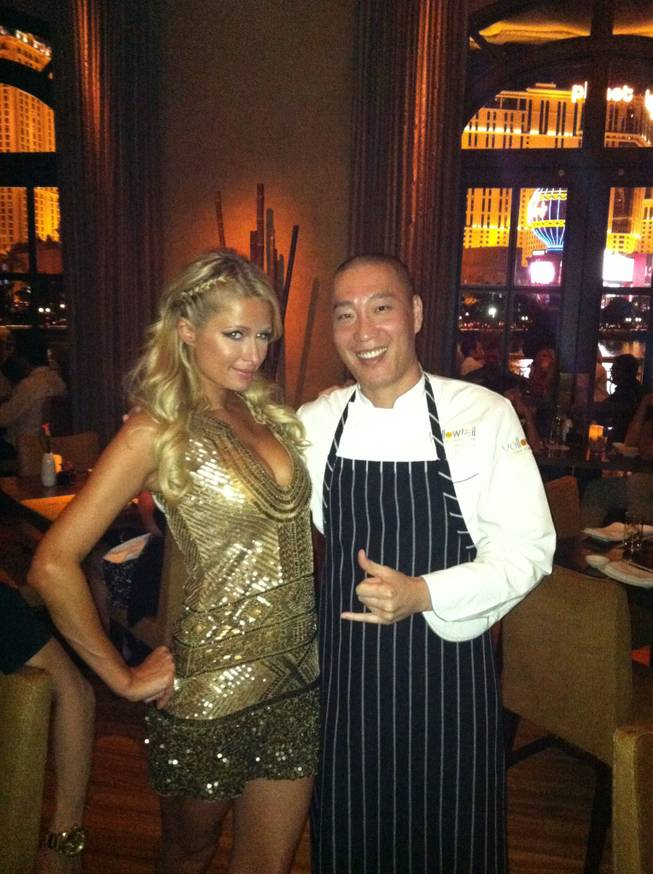 Paris Hilton and chef Akira Back at Yellowtail in the Bellagio on Saturday, Sept. 29, 2012.