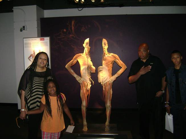 "Rev Run of Run-DMC with his family at ""Bodies: the Exhibit"" at the Luxor."