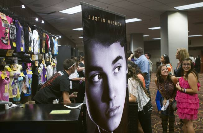 Justin Bieber fans line up for merchandise at the MGM Grand Garden Arena during a concert on September 30, 2012.