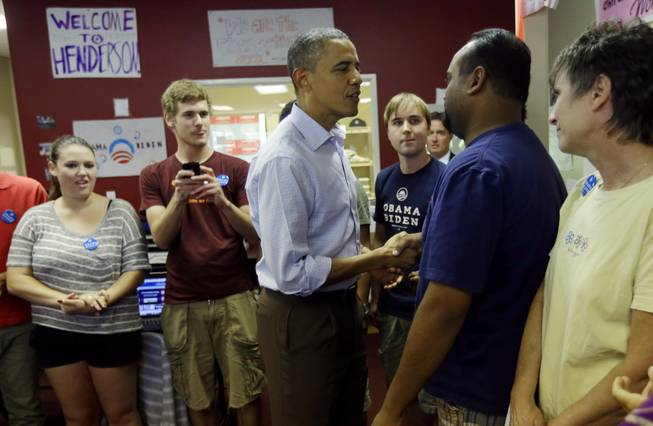 President Barack Obama greets volunteers during a visit to a local campaign office, Monday, Oct. 1, 2012 in Henderson, Nev.