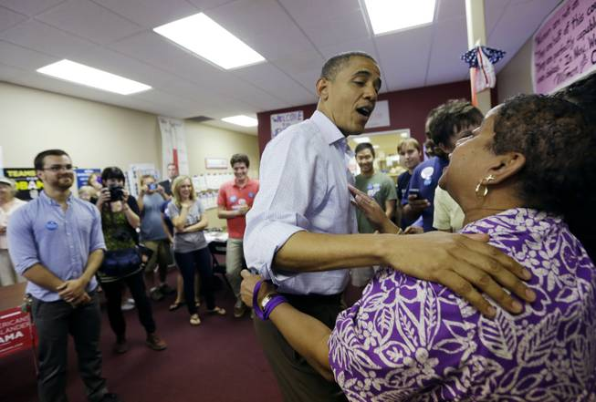 President Barack Obama greets supporters during a visit to a local campaign office Monday, Oct. 1, 2012, in Henderson.