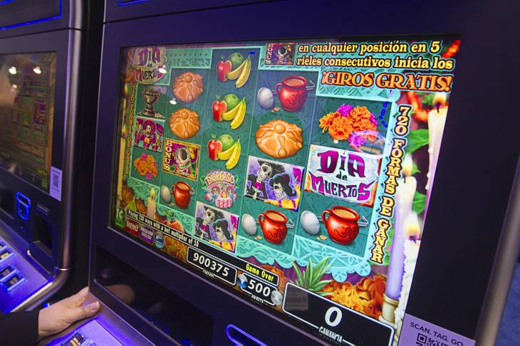 A Day of the Dead-themed slot machine by IGT is displayed during the Global Gaming Expo (G2E) at the Sands Expo Center Tuesday, Oct. 2, 2012. The language on the machine changes from English to Spanish at the touch of a button
