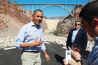 President Barack Obama talks to the media while visiting the Hoover Dam during a break from debate preparations Tuesday, Oct. 2, 2012.