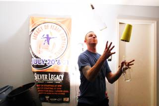 Local flair bartender Eric Parker practices in his garage in Las Vegas on Tuesday, October 2, 2012.