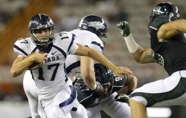 UNR quarterback Cody Fajardo (left) cuts away from Hawaii linebacker Brenden Daley during the Wolf Pack's blowout victory on Saturday, Sept. 22, 2012. The difference in talent in the Mountain West right doesn't get any larger than between these two teams.