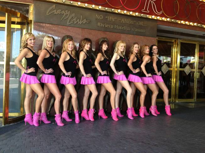 The dancers of <em>Crazy Girls</em> pose in front of the famous bronze outside the Riviera as part of the show's 25th anniversary celebration.