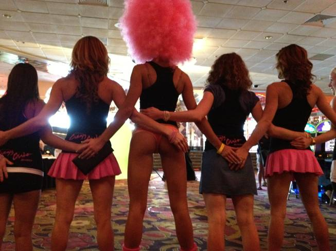 "The dancers join volunteers for a practice run of ""Las Vegas' Longest Butt Lineup"" inside the casino."