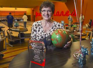 Bowler Irma Wenzel, 79, poses by her trophy during practice at Red Rock Lanes in the Red Rock Resort Wednesday, Oct. 3 2012. Wenzel was recognized Wednesday for bowling a perfect game at the bowling center on Sept. 26.