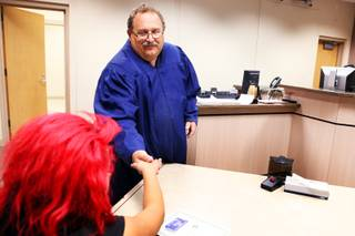 Judge Stephen Compan hands Diana, 15, her certificate of graduation from the diversion court program held at Clark County Family Courts in Las Vegas on Wednesday, October 3, 2012.