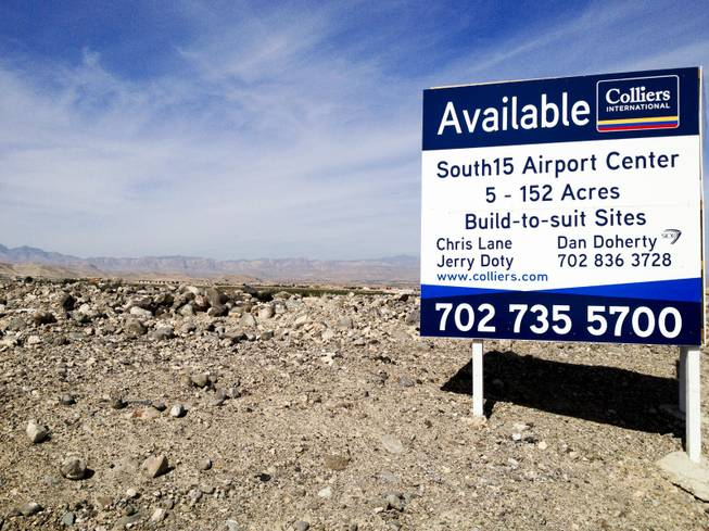 "Developers are planning to build a 2 million-square-foot industrial complex in Henderson known as ""South15 Airport Center."" Above, a sign advertises the land to prospective tenants, Wednesday, Oct. 3, 2012."