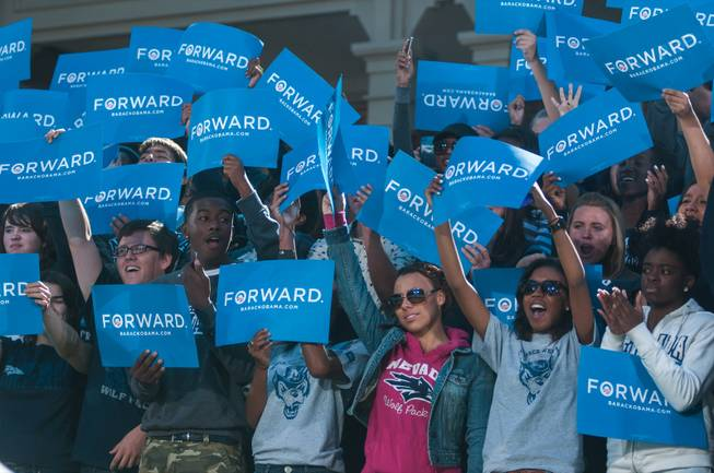 Supporters cheer first lady Michelle Obama as she speaks at the University of Nevada, Reno, Wednesday, Oct 3, 2012 in Reno, Nev.