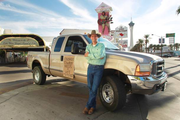 Colorado resident Darrell Diamond stands with his truck and spousal plea on the Strip Thursday, Oct. 4, 2012.