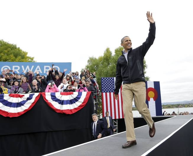President Barack Obama walks on stage during a campaign event at Sloan's Lake Park, Thursday, Oct. 4, 2012, in Denver.