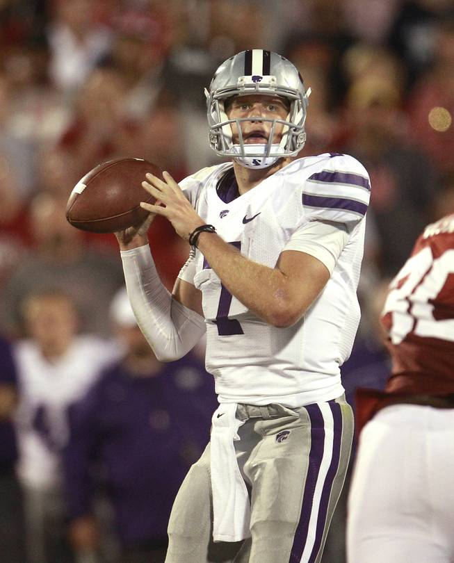 Kansas State quarterback Collin Klein (7) prepares to throw during an NCAA college football game against Oklahoma in Norman, Okla., Saturday, Sept. 22, 2012.