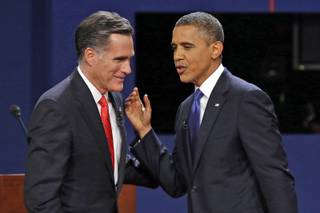 Republican presidential nominee Mitt Romney and President Barack Obama talk after their first presidential debate at the University of Denver on Wednesday, Oct. 3, 2012.