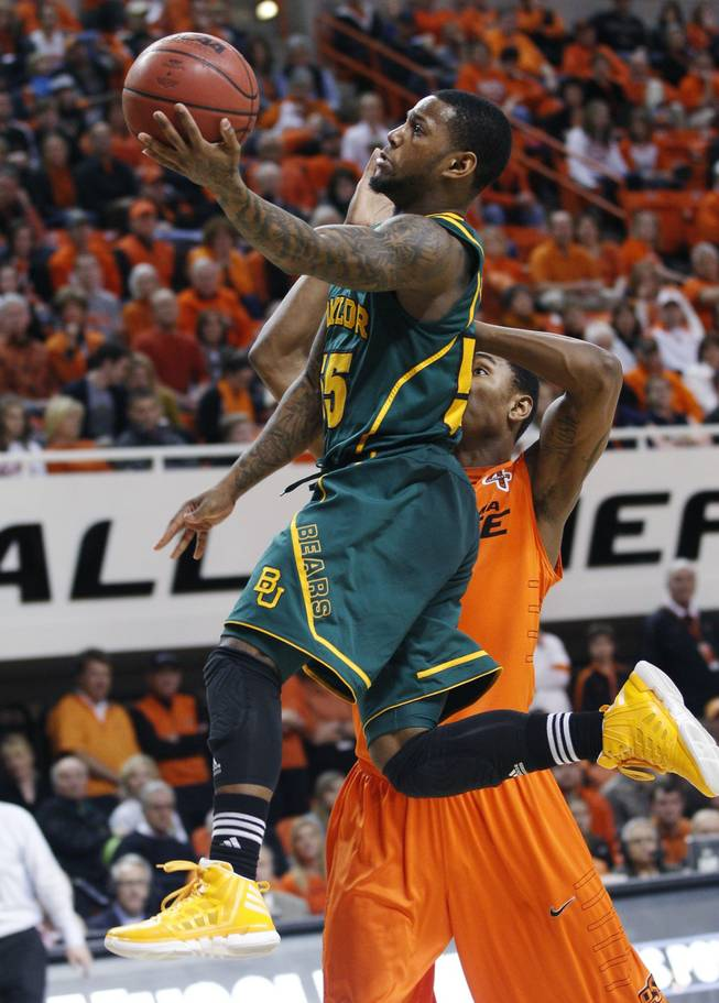 Baylor guard Pierre Jackson, left, goes up for a shot in front of Oklahoma State guard Le'Bryan Nash, right, in the second half of an NCAA college basketball game in Stillwater, Okla., Saturday, Feb. 4, 2012. Baylor won 64-60.