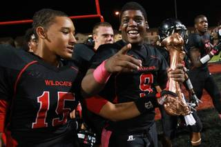 Las Vegas's Joshua Mayfield, left, and D'Anthony Wade celebrate beating Rancho in their annual