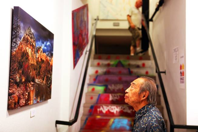 The Arts Factory is bustling with galleries and art appreciators, like this man, who did not want his name printed, checking out the work of photographer Thomas U. Knapp during First Friday in Las Vegas on Friday, October 5, 2012. First Friday celebrated it's tenth anniversary this year.