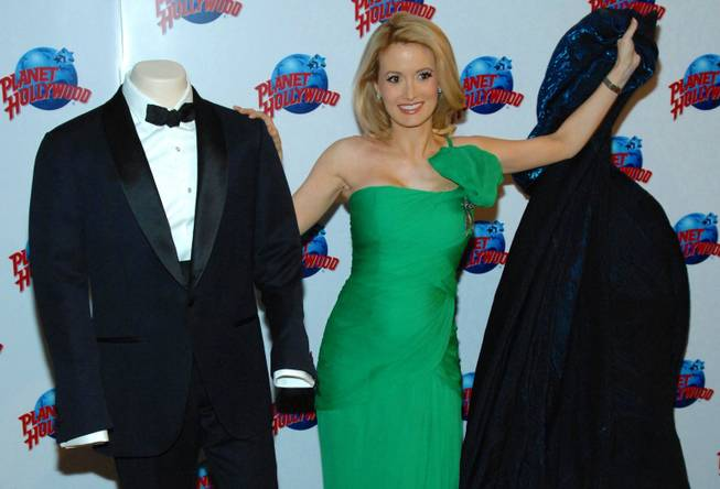 "Holly Madison unveils the Tom Ford tuxedo worn by Daniel Craig in the next James Bond film ""Skyfall"" at Planet Hollywood in the Forum Shops at Caesars Palace on Thursday, Oct. 4, 2012."