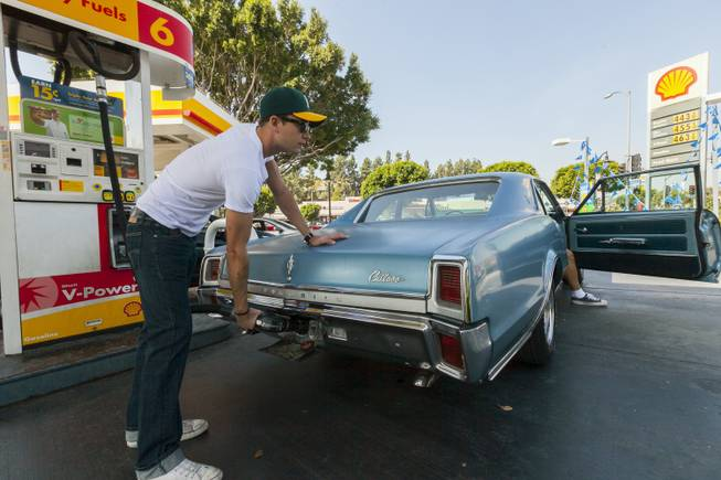Motorist Tony Klein fills up his 1967 Cutlass V-8 at a gas station in Los Angeles Thursday, Oct. 4, 2012. Motorists in California paid an average of $4.232 per gallon Wednesday. That's 45 cents higher than the national average and exceeded only by Hawaii among the 50 states.