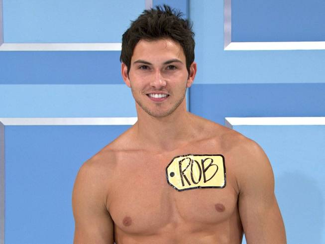 "This undated image from video shows Rob Wilson, of Boston, who was chosen in an online competition to be the first male model on the popular daytime game show, ""The Price is Right.""  Wilson begins his week-long stint alongside the ladies on Oct. 15. Hosted by Drew Carey, ""The Price Is Right"" airs weekdays at 11 a.m. Eastern time."