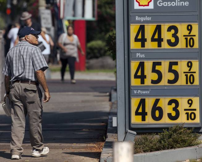 A pedestrian looks at high gasoline prices at a gas station in Los Angeles Thursday, Oct. 4, 2012. Motorists in California paid an average of $4.232 per gallon Wednesday. That's 45 cents higher than the national average and exceeded only by Hawaii among the 50 states.
