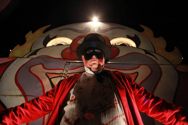 """The Ringmaster"" stands at the entrance of one of the Freakling Brothers Trilogy of Terror haunted houses in north west Las Vegas Saturday, Oct. 6, 2012."
