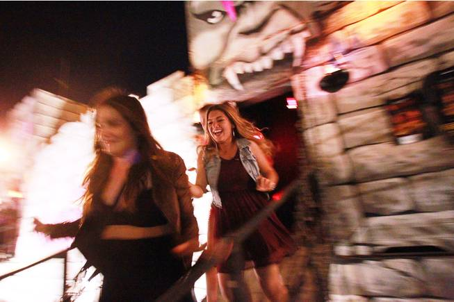 Shelby Sanchez and friends run screaming from one of the Freakling Brothers Trilogy of Terror haunted houses Saturday, Oct. 6, 2012.