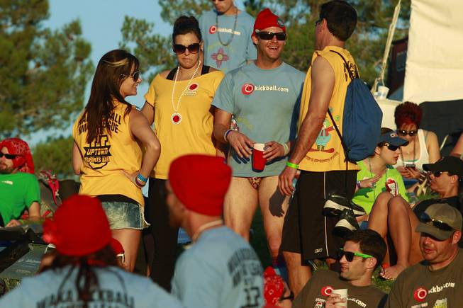 Competitors socialize between games during the World Adult Kickball Association Founders Cup Saturday, Oct. 6, 2012.