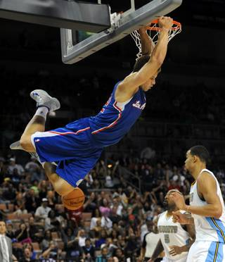 Los Angeles Clippers power forward Blake Griffin slam dunks against the Denver Nuggets during a preseason game at Mandalay Bay Events Center on Saturday, Oct. 6, 2012.