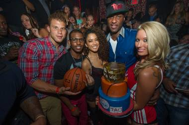 Chris Paul of the Los Angeles Clippers, second from right and with teammates Blake Griffin and Lamar Odom, hosts the preseason Baller's Ball at Tao in the Venetian on Friday, Oct. 5, 2012.