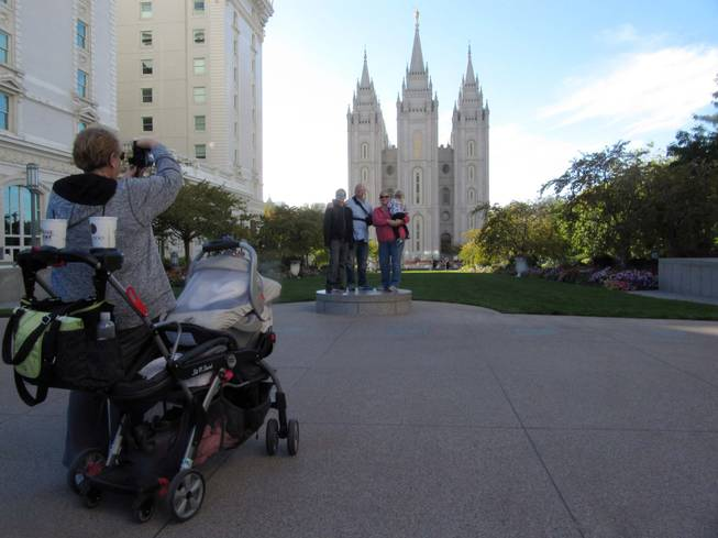 Brad and Jennifer Clower of Mountain Home, Idaho, pose with their children Oct. 5, 2012, outside the Mormon temple in downtown Salt Lake City. The Clowers will be visiting family and sightseeing during the semi-annual conference of The Church of Jesus Chris of Latter-day Saints this weekend, but they said they will record the conference sessions to watch later.