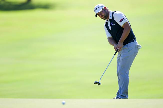 Former UNLV golfer Ryan Moore watches a putt roll onto the 10th green during the 2012 Justin Timberlake Shriners Hospitals for Children Open at TPC Summerlin Sunday, Oct. 7, 2012.