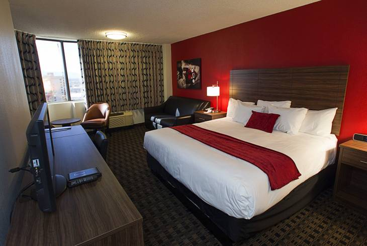 A renovated corner room with a king-size bed is shown at the D Las Vegas in downtown Las Vegas Tuesday, Oct. 9, 2012. The casino, formerly Fitzgeralds, is celebrating it's rebranding and renovation with festivities this weekend.