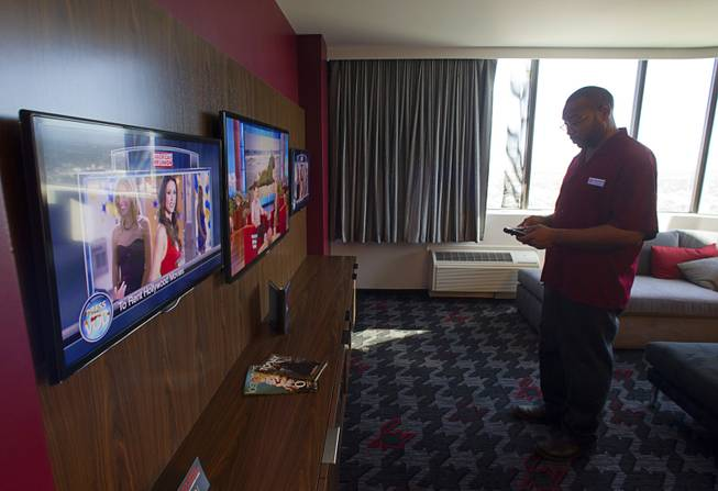 Housekeeping supervisor Jermaine Vincent checks the operation of television remotes in a renovated suite at the D Las Vegas in downtown Las Vegas Tuesday, Oct. 9, 2012. The casino, formerly Fitzgeralds, is celebrating it's rebranding and renovation with festivities this weekend.