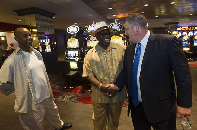 Derek Stevens, right, CEO of the D Las Vegas, greets friend Chuck William, center, and Dess Mebra at the D Las Vegas in downtown Las Vegas Tuesday, Oct. 9, 2012. The casino, formerly Fitzgeralds, is celebrating it's rebranding and renovation with festivities this weekend.