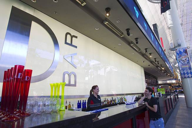 Flair bartender Erin Ferreira talks with a kiosk vendor at the D Las Vegas in downtown Las Vegas Tuesday, Oct. 9, 2012. The casino, formerly Fitzgeralds, is celebrating it's rebranding and renovation with festivities this weekend.