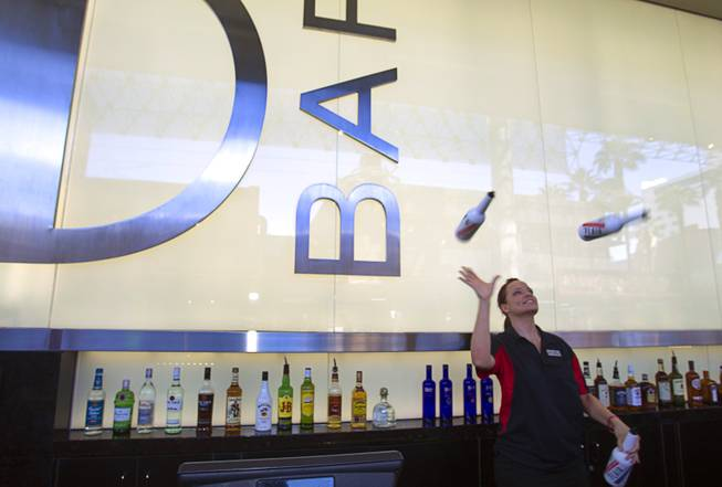 Flair bartender Erin Ferreira juggles bottles at the D Las Vegas in downtown Las Vegas Tuesday, Oct. 9, 2012. The casino, formerly Fitzgeralds, is celebrating it's rebranding and renovation with festivities this weekend.