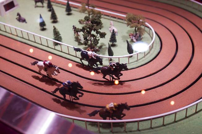 "Horses race in a Sigma Derby game on a ""Vintage Vegas"" casino floor at the D Las Vegas in downtown Las Vegas Tuesday, Oct. 9, 2012. The casino had to reapply to have the game approved in Nevada because the original approval had expired, said CEO Derek Stevens. The casino, formerly Fitzgeralds, is celebrating it's rebranding and renovation with festivities this weekend."