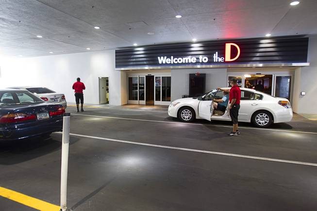 A guest picks up a car from valet at the D Las Vegas in downtown Las Vegas Tuesday, Oct. 9, 2012. The casino, formerly Fitzgeralds, is celebrating it's rebranding and renovation with festivities this weekend.