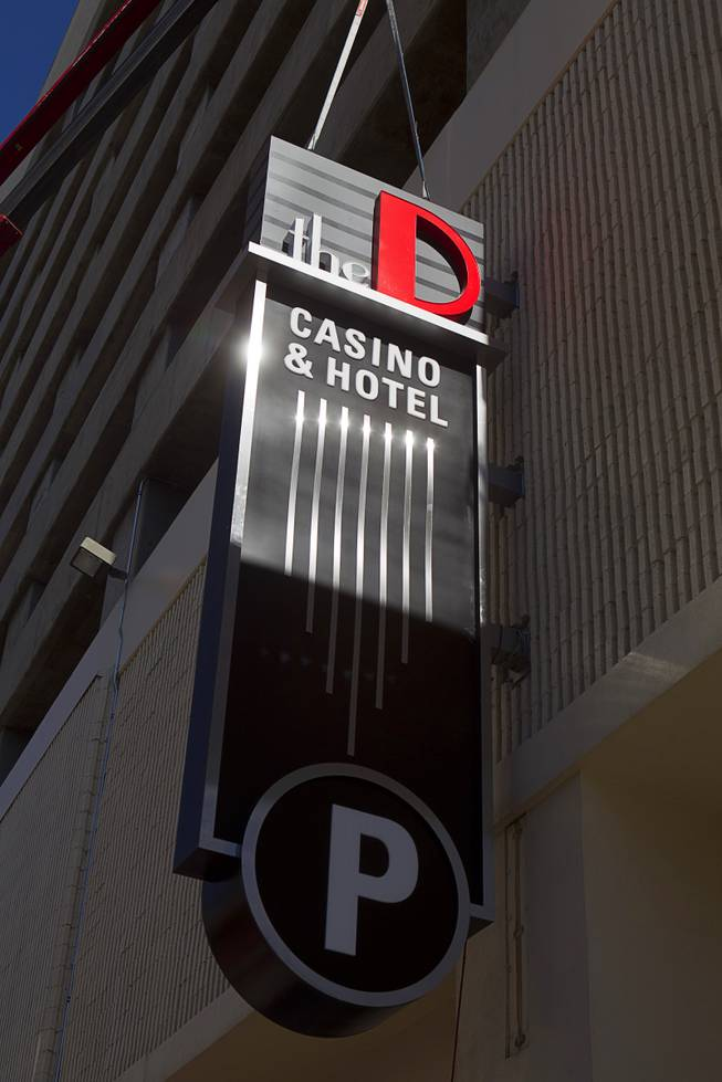 New signage is hung at the parking garage entrance to the D Las Vegas in downtown Las Vegas Tuesday, Oct. 9, 2012. The casino, formerly Fitzgeralds, is celebrating it's rebranding and renovation with festivities this weekend.
