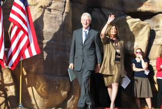 Former President Bill Clinton enters the stage with U.S. Rep. Shelley Berkley, D-Nev. during a rally at the Springs Preserve in Las Vegas on Tuesday, October 9, 2012.