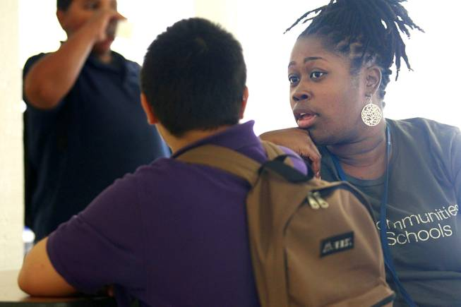 Communities in Schools coordinator Kalan Washington talks to a student about why he isn't meeting the goals they established together at Bridger Middle School Tuesday, Oct. 9, 2012.