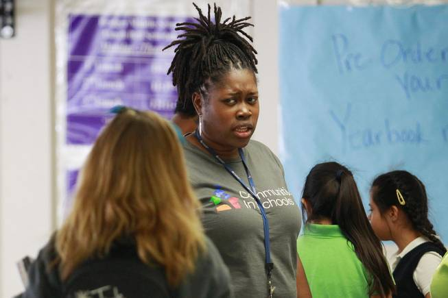 Communities in Schools coordinator Kalan Washington questions a student about why she doesn't want to stand in line for lunch at Bridger Middle School Tuesday, Oct. 9, 2012.