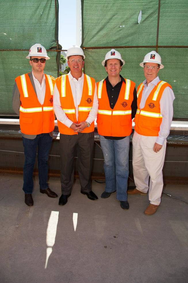 Nick McCabe, VP of Strategy for Angel Management Group, Scott Sibella, president and COO of MGM Grand, Neil Moffitt, CEO of Angel Management Group, and Eric Barth, director of operations for Hakkasan Las Vegas, sign the final construction beam at Hakkasan Las Vegas in MGM Grand on Tuesday, Oct. 9, 2012.