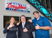 American Coney Island Chili Dogs opens Wednesday, Oct. 10, 2012, at The D Las Vegas downtown. Owners Grace Keros and Chris Sotiropoulos flank The D owner Derek Stevens.