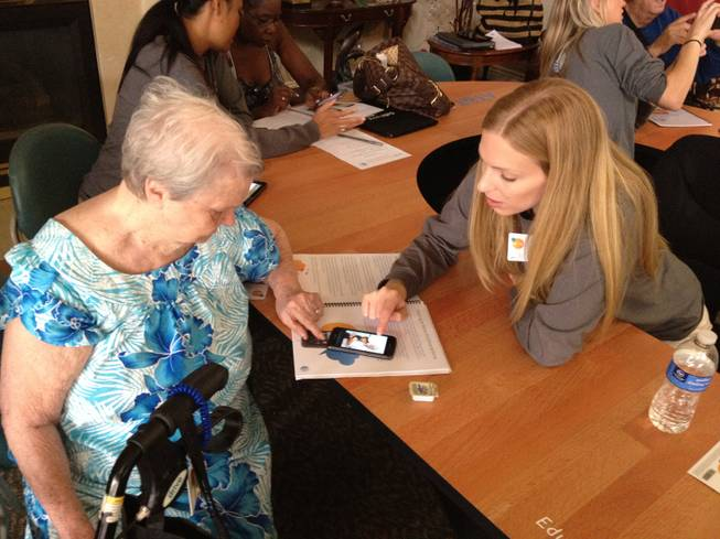 AT&T employees help residents learn to use a smart phone at the Atria Sutton senior living home, 3185 E. Flamingo Road, on Oct. 10, 2012. The workshop was part of the nationwide AT&T Reconnect Tour, which teaches seniors the basics of using a smart phone and the Internet.