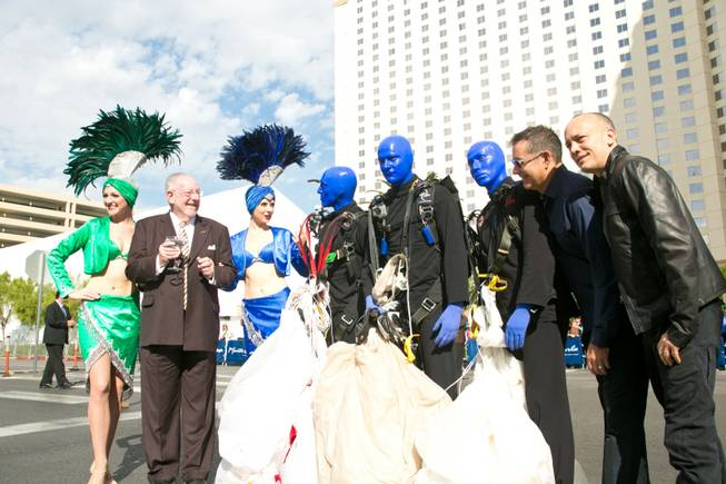 From left to right: former Mayor of Las Vegas Oscar Goodman and his showgirls, The Blue Man Group, and founders of Blue Man Group Phil Stanton and Chris Wink on the opening day of their new show at the Monte Carlo, Wednesday Oct. 10, 2012.