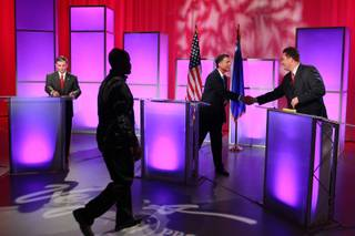 Third Congressional District  candidates Dr. Joe Heck, left, wraps up while moderator Mitch Fox shakes John Oceguera's hand after a debate at Vegas PBS Thursday, Oct. 11, 2012. Photography was not permitted during the debate.