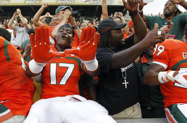 Miami quarterback Stephen Morris (17) celebrates the Hurricanes' 42-36 overtime win over Georgia Tech in an NCAA college football game in Atlanta on Saturday, Sept. 22, 2012.